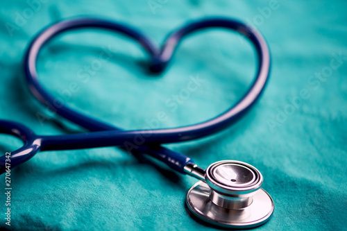 A stethoscope shaping a heart on a medical uniform, closeup - 270647342