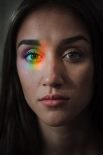 Portrait Of Young Woman With Rainbow On Her Eye