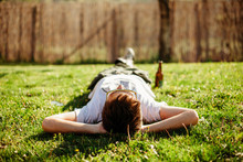 Man Lying On The Grass Illumin...