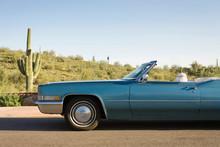 Vintage Car On Desert Road Trip In Arizona