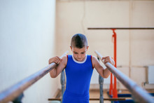Gymnastics, Young Boy Practicing On Parallel Bars