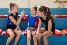 Gymnastic, Happy Young Girls Sitting At The Bench And Talking