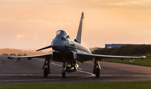 Backlit Typhoon Taxis Out For Takeoff