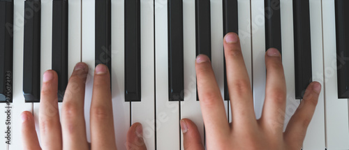 piano keys and playing piano - 270672123