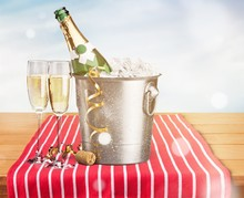 Two Glasses Of Champagne And Bottle On Background