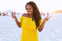 Black Woman In Pretty Sun Dress On The Beach
