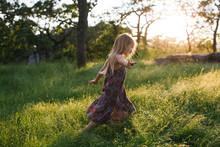 Smiling Girl Running In Field