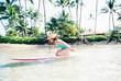 Maui surfer girl in blue ocean