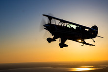 Biplane At Sunset