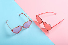 Funky Heart Shaped Sunglasses On Color Background