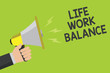 Leinwanddruck Bild - Handwriting text Life Work Balance. Concept meaning stability person needs between his job and personal time Announcement symbol speaker alarming warning signalling indication idea
