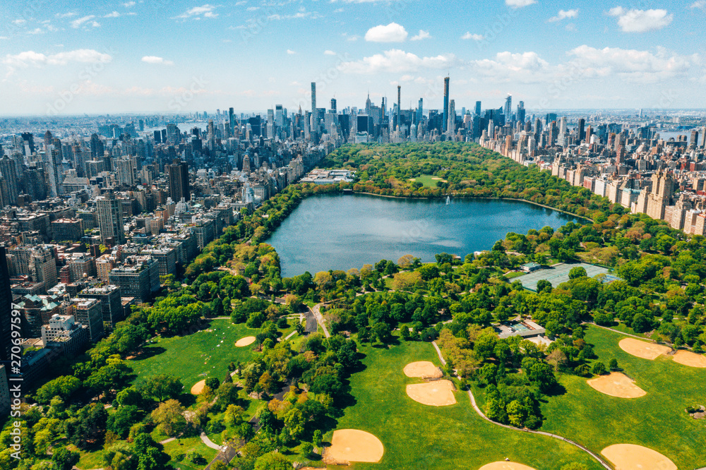 Fototapety, obrazy: Central Park aerial view, Manhattan, New York. Park is surrounded by skyscraper. Beautiful view of the Jacqueline Kennedy Onassis Reservoir in the center of the park.