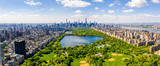 Fototapeta New York - Central Park aerial view, Manhattan, New York. Park is surrounded by skyscraper. Beautiful view of the Jacqueline Kennedy Onassis Reservoir in the center of the park.