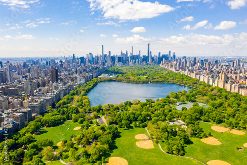 Aerial view of the Central park in New York with golf fields and tall skyscrapers surrounding the park. - 270697519