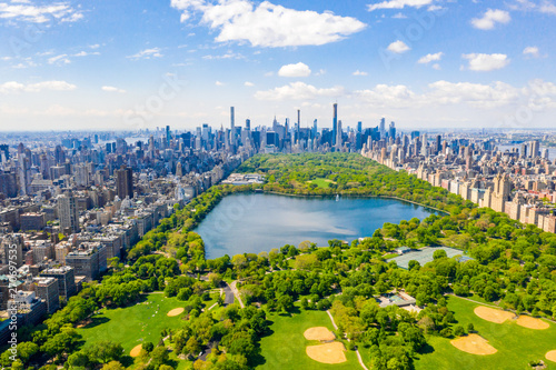 Aerial view of the Central park in New York with golf fields and tall skyscrapers surrounding the park. - 270697535