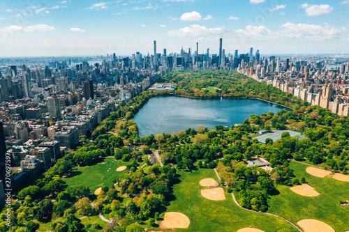 Central Park aerial view, Manhattan, New York. Park is surrounded by skyscraper. Beautiful view of the Jacqueline Kennedy Onassis Reservoir in the center of the park. - 270697597