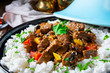 canvas print picture - Tajin beef stew with rice paprika and sesame seeds