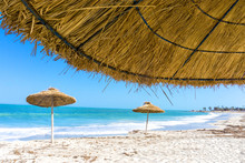 Parasols On The Beach Of Djerba In Tunisia