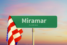 Miramar – Florida. Road Or Town Sign. Flag Of The United States. Sunset Oder Sunrise Sky
