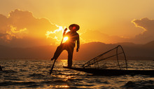 Silhouettes Fisherman Fishing At Lake. Silhouette Man On Boat On River Sunset At Inlay Myanmar Local People Asian.