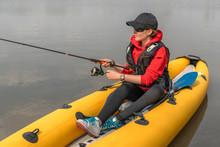 Kayak Fishing At Lake. Fisherw...