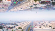 Modern City With Mirror Effect. Stock Footage. Abstract Animation With Effect Of Parallel Reality Of Reflected Metropolis. Top View Of City Panorama Mirrored From Above Like Parallel Worlds