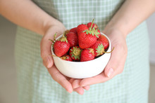 Woman With Bowl Of Red Strawbe...