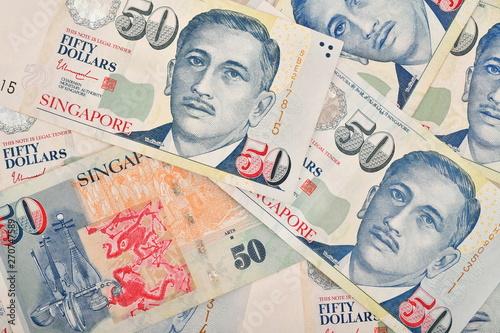 Close up of fifty singapore dollar on many singapore money