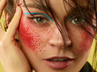 Strawberry eyes. Beautiful female face with perfect skin and bright make up. Concept of natural beauty, skin care, treatment, health, cosmetic. A creative artistic stage act and signature character.