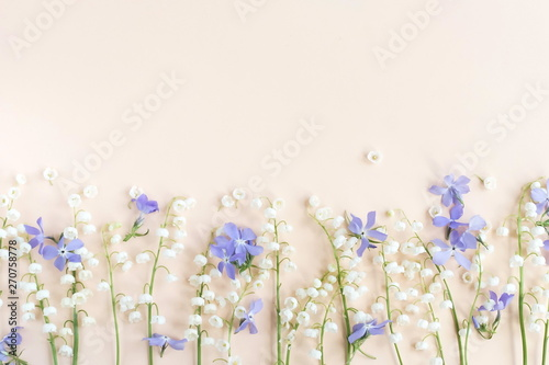 Keuken foto achterwand Bloemen Floral pattern of a spring flowers Lily of the Valley Bouquet on a pale pink background. top view. flat lay. Holiday concept. Copy space