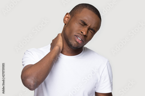 Photo African man feels unhealthy closed his eyes for neck pain