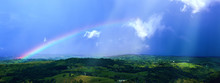 Impressive View At The Tropical Tableland With A Colourful Rainbow During Rainseason.A Heavy Tropical Rain Falling Down On The Forests And Valleys. Millaa Millaa Lookout,Far North Queensland,Australia