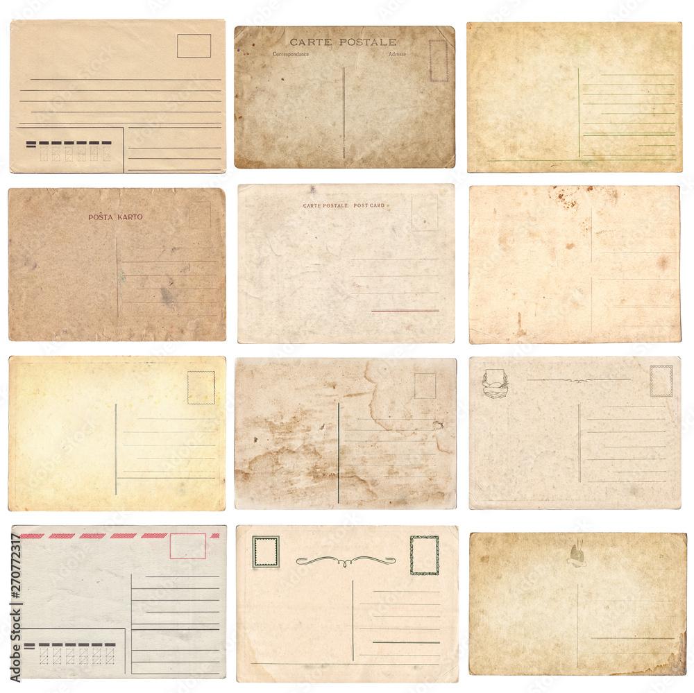 Fototapeta Set of various old vintage postcards isolated on white