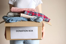 Girl Holding A Box With Donations