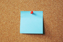 Paper Note Reminder Sticky Notes Pin Paper Blue  On Cork Bulletin Board. Empty Space For Text. Soft Focus.