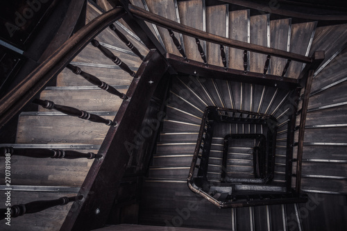Leinwand Poster Old wooden spiral staircase without people top view