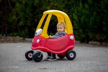 Cute Toddler Boy, Riding Big P...