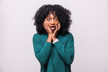 Portrait Of Beautiful Scared Young African Woman Female With Curly Hairstyle Shocked Isolated On White Background