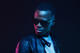 Close-up portrait of stylish black young man, wearing leather jacket and sunglasses