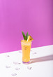 Leinwandbild Motiv iced pineapple punch cocktail in glass on color background. summer drink.