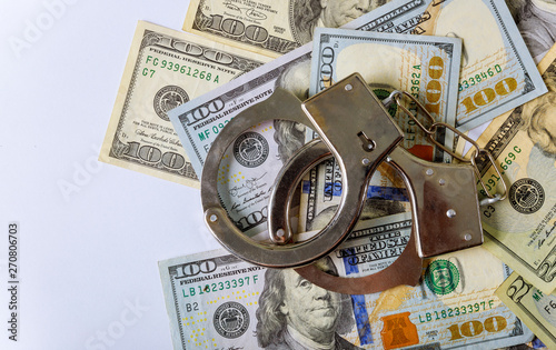 100 US dollars banknotes of counterfeit money and handcuffs Fototapeta