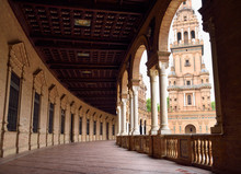 South Tower With Curved Roofed Walkway With Pillars At Plaza De Espana Seville Spain