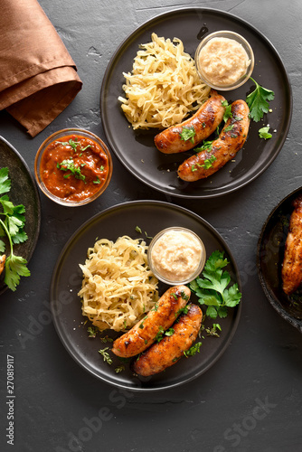 Stewed sauerkraut with grilled sausages Fototapeta