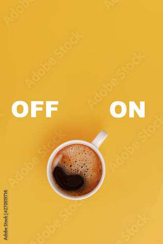 Cup of coffee on yellow background, switched on, concept Canvas Print
