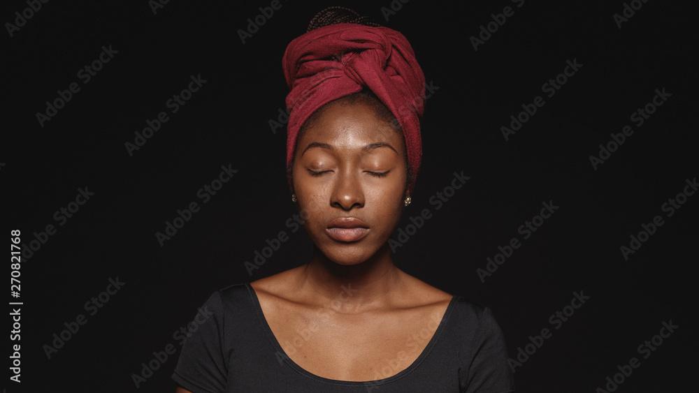 Fototapeta Portrait of african woman in a headwrap