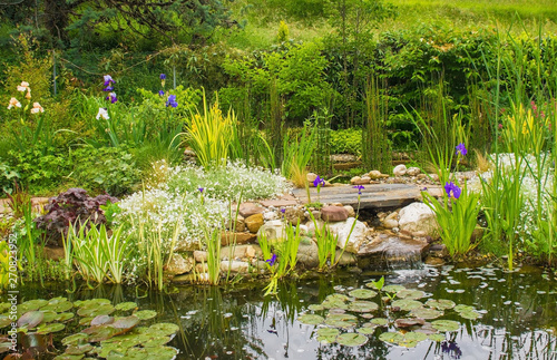 Obraz na plátně  A pond in a north east Italian garden during the spring