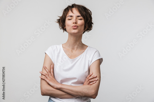 Image of beautiful woman in basic t-shirt looking at camera while standing with Canvas-taulu