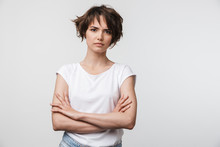 Portrait Of Serious Woman With Short Brown Hair In Basic T-shirt Frowning And Looking At Camera