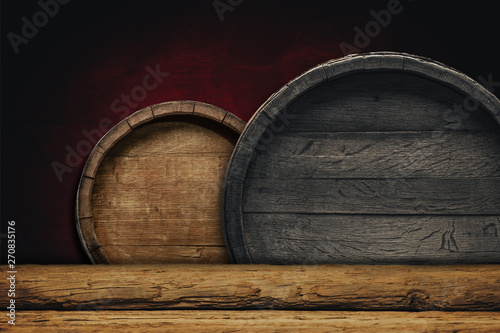 Fotografía Wooden barrel background and worn old table of wood.