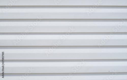 Fényképezés New white vinyl siding on wall